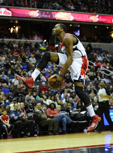 Jan 20, 2014; Washington, DC, USA; Washington Wizards point guard John Wall (2) puts the ball between his legs after the whistle during the first half against the Philadelphia 76ers at Verizon Center. Mandatory Credit: Brad Mills-USA TODAY Sports