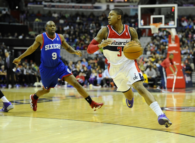 Jan 20, 2014; Washington, DC, USA; Washington Wizards shooting guard Bradley Beal (3) dribbles as Philadelphia 76ers shooting guard James Anderson (9) defends during the first half at Verizon Center. Mandatory Credit: Brad Mills-USA TODAY Sports