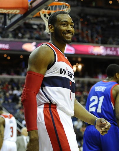 Jan 20, 2014; Washington, DC, USA; Washington Wizards point guard John Wall (2) reacts against the Philadelphia 76ers during the first half at Verizon Center. Mandatory Credit: Brad Mills-USA TODAY Sports