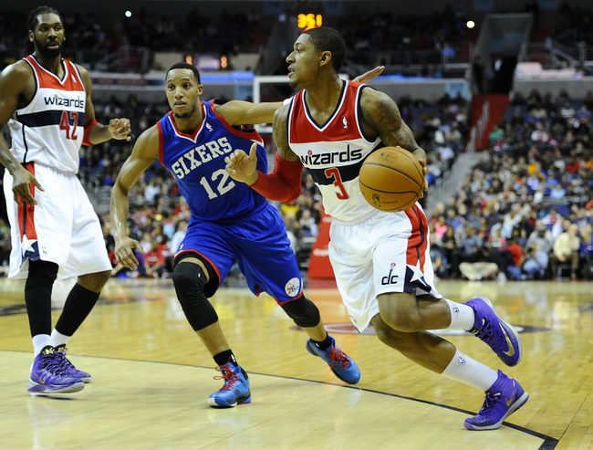 Jan 20, 2014; Washington, DC, USA; Washington Wizards shooting guard Bradley Beal (3) dribbles as Philadelphia 76ers small forward Evan Turner (12) defends during the first half at Verizon Center. Mandatory Credit: Brad Mills-USA TODAY Sports
