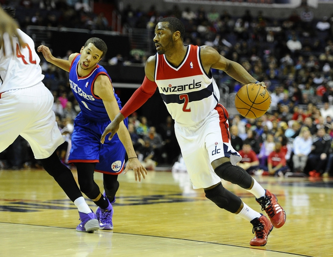 Jan 20, 2014; Washington, DC, USA; Washington Wizards point guard John Wall (2) dribbles as Philadelphia 76ers point guard Michael Carter-Williams (1) defends during the first half at Verizon Center. Mandatory Credit: Brad Mills-USA TODAY Sports