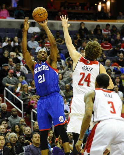 Jan 20, 2014; Washington, DC, USA; Philadelphia 76ers power forward Thaddeus Young (21) shoots over Washington Wizards power forward Jan Vesely (24) during the second half at Verizon Center. The Wizards defeated the 76ers 107 - 99. Mandatory Credit: Brad Mills-USA TODAY Sports