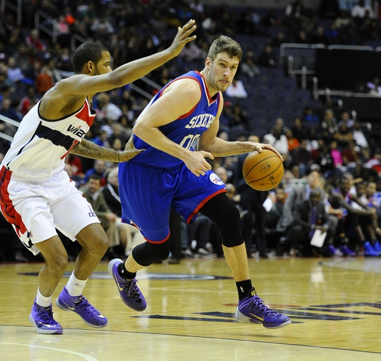 Jan 20, 2014; Washington, DC, USA; Philadelphia 76ers center Spencer Hawes (00) dribbles as Washington Wizards shooting guard Garrett Temple (17) defends during the second half at Verizon Center. The Wizards defeated the 76ers 107 - 99. Mandatory Credit: Brad Mills-USA TODAY Sports