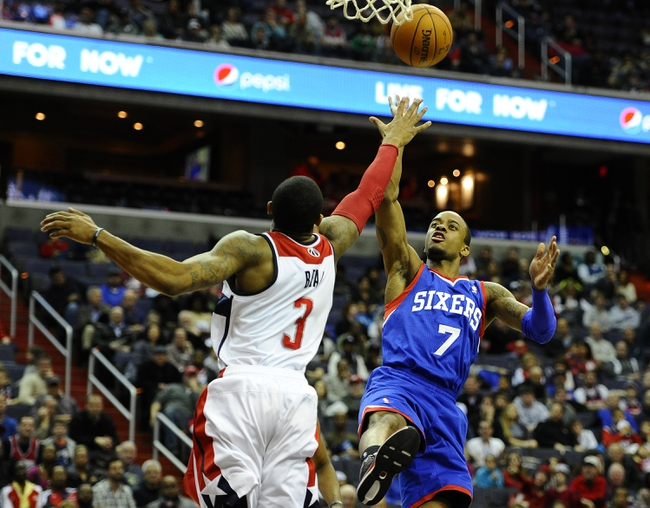 Jan 20, 2014; Washington, DC, USA; Philadelphia 76ers point guard Lorenzo Brown (7) shoots over Washington Wizards shooting guard Bradley Beal (3) during the second half at Verizon Center. The Wizards defeated the 76ers 107 - 99. Mandatory Credit: Brad Mills-USA TODAY Sports