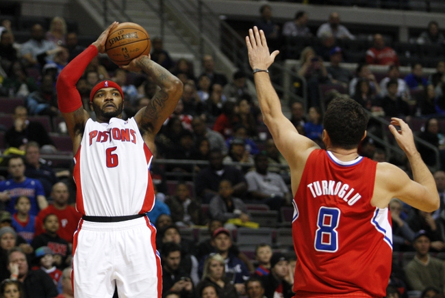 Jan 20, 2014; Auburn Hills, MI, USA; Detroit Pistons small forward Josh Smith (6) takes a shot over Los Angeles Clippers small forward Hedo Turkoglu (8) during the fourth quarter at The Palace of Auburn Hills. Clippers beat the Pistons 112-103. Mandatory Credit: Raj Mehta-USA TODAY Sports