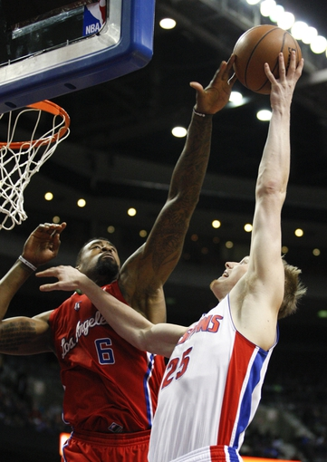 Jan 20, 2014; Auburn Hills, MI, USA; Detroit Pistons small forward Kyle Singler (25) gets his shot blocked by Los Angeles Clippers center DeAndre Jordan (6) during the fourth quarter at The Palace of Auburn Hills. Clippers beat the Pistons 112-103. Mandatory Credit: Raj Mehta-USA TODAY Sports