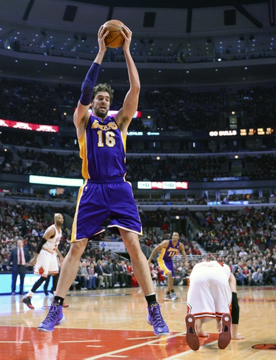 Jan 20, 2014; Chicago, IL, USA; Los Angeles Lakers center Pau Gasol (16) grabs a rebound against the Chicago Bulls during the first half at United Center. Mandatory Credit: Mike DiNovo-USA TODAY Sports
