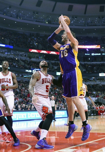 Jan 20, 2014; Chicago, IL, USA; Los Angeles Lakers center Pau Gasol (16) shoot the ball against Chicago Bulls power forward Carlos Boozer (5) during the first half at United Center. Mandatory Credit: Mike DiNovo-USA TODAY Sports