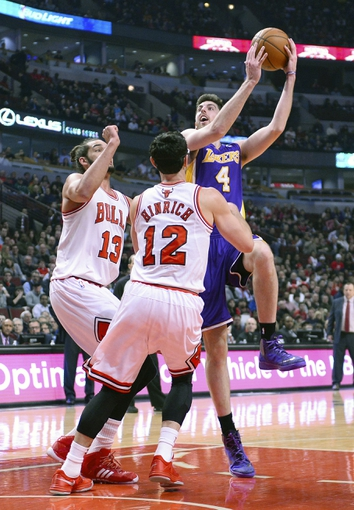 Jan 20, 2014; Chicago, IL, USA; Los Angeles Lakers power forward Ryan Kelly (4) shoots the ball against Chicago Bulls center Joakim Noah (13) during the first half at United Center. Mandatory Credit: Mike DiNovo-USA TODAY Sports