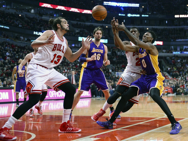 Jan 20, 2014; Chicago, IL, USA; Los Angeles Lakers small forward Nick Young (0) loses the ball against Chicago Bulls shooting guard Jimmy Butler (21) and center Joakim Noah (13) during the first half at United Center. Mandatory Credit: Mike DiNovo-USA TODAY Sports