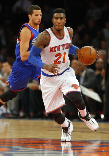 Jan 22, 2014; New York, NY, USA;  New York Knicks shooting guard Iman Shumpert (21) brings the ball up court during the second half against the Philadelphia 76ers at Madison Square Garden. Philadelphia 76ers defeat the New York Knicks 110-105. Mandatory Credit: Jim O'Connor-USA TODAY Sports