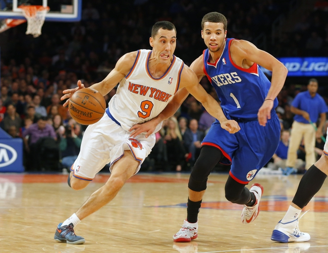 Jan 22, 2014; New York, NY, USA;  New York Knicks point guard Pablo Prigioni (9) drives to the basket during the second half against Philadelphia 76ers point guard Michael Carter-Williams (1) at Madison Square Garden. Philadelphia 76ers defeat the New York Knicks 110-105. Mandatory Credit: Jim O'Connor-USA TODAY Sports