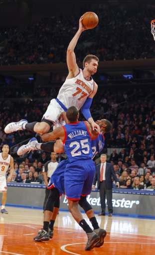 Jan 22, 2014; New York, NY, USA;  New York Knicks center Andrea Bargnani (77) drives to the basket and is fouled by Philadelphia 76ers power forward Thaddeus Young (21) during the second half at Madison Square Garden. Philadelphia 76ers defeat the New York Knicks 110-105. Mandatory Credit: Jim O'Connor-USA TODAY Sports