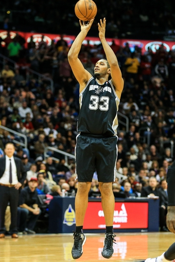 Jan 24, 2014; Atlanta, GA, USA; San Antonio Spurs power forward Boris Diaw (33) shoots a three in the second half against the Atlanta Hawks at Philips Arena. The Spurs won 105-79. Mandatory Credit: Daniel Shirey-USA TODAY Sports