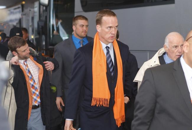 Jan 26, 2014; Jersey City, NJ, USA;  Denver Broncos quarterback Peyton Manning arrives at the Hyatt Regency hotel. Mandatory Credit: Jim O'Connor-USA TODAY Sports