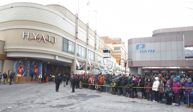 Jan 26, 2014; Jersey City, NJ, USA;  Denver Broncos fans wait for the team to arrive at the Hyatt Regency hotel in Jersey City. Mandatory Credit: Jim O'Connor-USA TODAY Sports