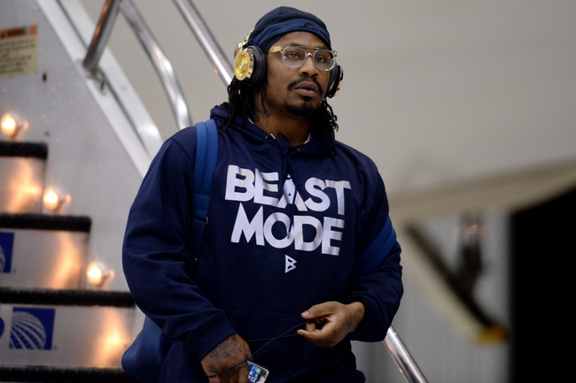 Jan 26, 2014; Newark, NJ, USA; Seattle Seahawks running back Marshawn Lynch arrives at Newark Liberty International Airport to face the Denver Broncos in Super Bowl XLVIII. Mandatory Credit: Joe Camporeale-USA TODAY Sports