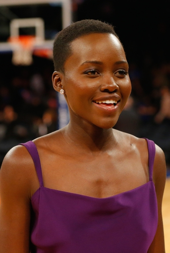 Jan 22, 2014; New York, NY, USA;  Entertainer actress Lupita Nyong'o from '12 Years A Slave' at Madison Square Garden. Philadelphia 76ers defeat the New York Knicks 110-105. Mandatory Credit: Jim O'Connor-USA TODAY Sports
