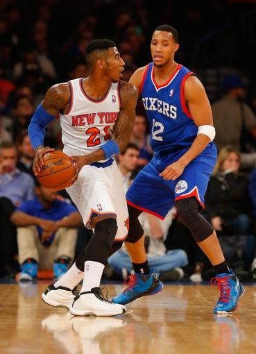 Jan 22, 2014; New York, NY, USA;  New York Knicks shooting guard Iman Shumpert (21) works against Philadelphia 76ers small forward Evan Turner (12) at Madison Square Garden. Mandatory Credit: Jim O'Connor-USA TODAY Sports