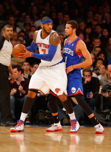 Jan 22, 2014; New York, NY, USA;  New York Knicks small forward Carmelo Anthony (7) works against Philadelphia 76ers point guard Michael Carter-Williams (1) during the first half at Madison Square Garden. Mandatory Credit: Jim O'Connor-USA TODAY Sports