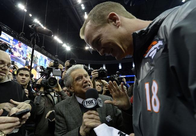 Jan 28, 2014; Newark, NJ, USA; Fox Sports analyst Regis Philbin interviews Denver Broncos quarterback Peyton Manning (18) during Media Day for Super Bowl XLVIII at Prudential Center. Mandatory Credit: Robert Deutsch-USA TODAY Sports