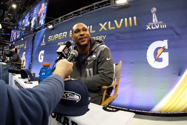 Jan 28, 2014; Newark, NJ, USA; Seattle Seahawks wide receiver Percy Harvin (11) is interviewed during Media Day for Super Bowl XLIII at Prudential Center. Mandatory Credit: Brad Penner-USA TODAY Sports
