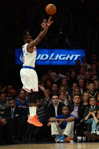 Jan 28, 2014; New York, NY, USA; New York Knicks shooting guard Tim Hardaway Jr. (5) shoots against the Boston Celtics during the first half at Madison Square Garden. Mandatory Credit: Joe Camporeale-USA TODAY Sports