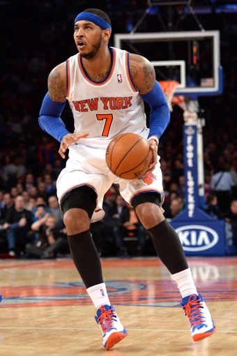Jan 28, 2014; New York, NY, USA; New York Knicks small forward Carmelo Anthony (7) pulls up for a shot against the Boston Celtics during the second half at Madison Square Garden. The New York Knicks won the game 114-88. Mandatory Credit: Joe Camporeale-USA TODAY Sports