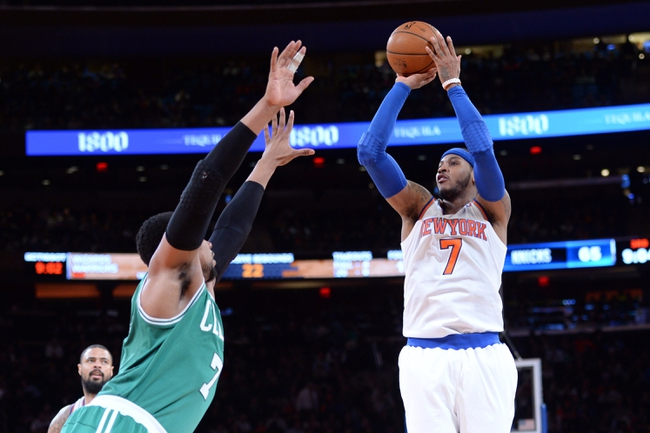 Jan 28, 2014; New York, NY, USA; New York Knicks small forward Carmelo Anthony (7) shoots over Boston Celtics center Jared Sullinger (7) during the second half at Madison Square Garden. The New York Knicks won the game 114-88. Mandatory Credit: Joe Camporeale-USA TODAY Sports