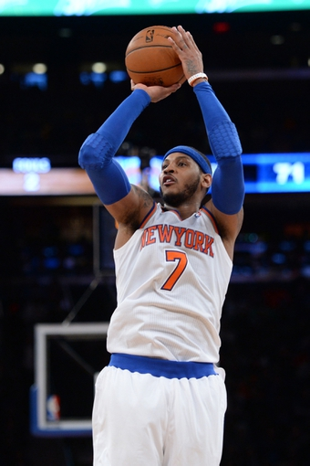 Jan 28, 2014; New York, NY, USA; New York Knicks small forward Carmelo Anthony (7) takes a shot against the Boston Celtics during the second half at Madison Square Garden. The New York Knicks won the game 114-88. Mandatory Credit: Joe Camporeale-USA TODAY Sports