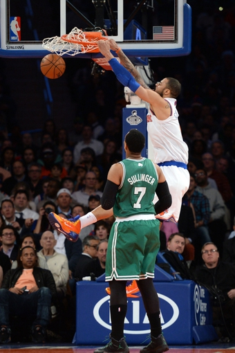 Jan 28, 2014; New York, NY, USA; New York Knicks center Tyson Chandler (6) dunks against the Boston Celtics during the first half at Madison Square Garden. Mandatory Credit: Joe Camporeale-USA TODAY Sports