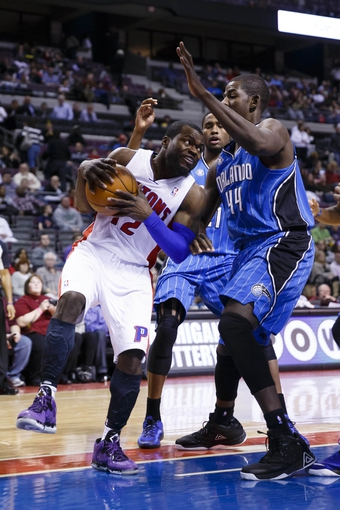 Jan 28, 2014; Auburn Hills, MI, USA; Detroit Pistons point guard Will Bynum (12) is defended by Orlando Magic power forward Andrew Nicholson (44) in the second half at The Palace of Auburn Hills. Detroit 103-87. Mandatory Credit: Rick Osentoski-USA TODAY Sports