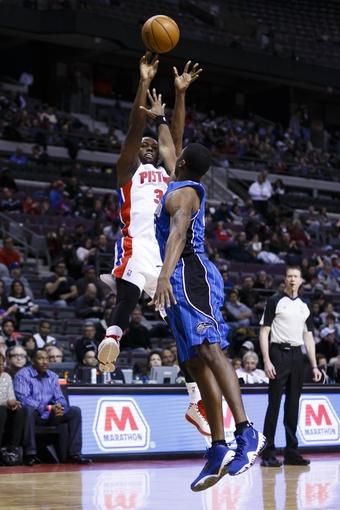 Jan 28, 2014; Auburn Hills, MI, USA; Detroit Pistons shooting guard Rodney Stuckey (3) shoots over Orlando Magic point guard E'Twaun Moore (55) in the second half at The Palace of Auburn Hills. Mandatory Credit: Rick Osentoski-USA TODAY Sports