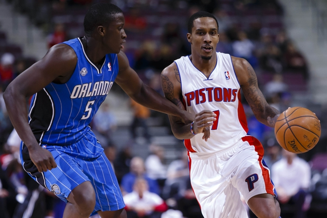 Jan 28, 2014; Auburn Hills, MI, USA; Detroit Pistons point guard Brandon Jennings (7) moves the ball defended by Orlando Magic shooting guard Victor Oladipo (5) in the second half at The Palace of Auburn Hills. Detroit 103-87. Mandatory Credit: Rick Osentoski-USA TODAY Sports