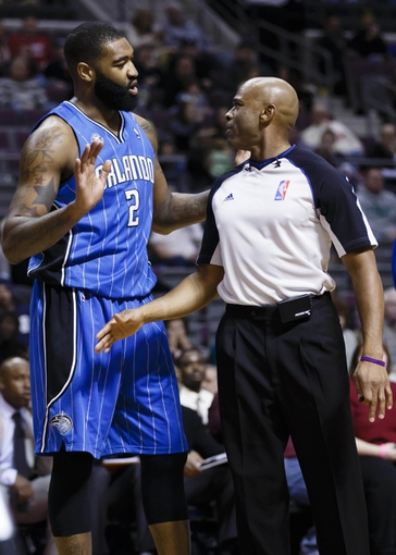 Jan 28, 2014; Auburn Hills, MI, USA; Orlando Magic power forward Kyle O'Quinn (2) talks to referee Tre Maddox (73) after being called for a foul in the second half against the Detroit Pistons at The Palace of Auburn Hills. Detroit 103-87. Mandatory Credit: Rick Osentoski-USA TODAY Sports