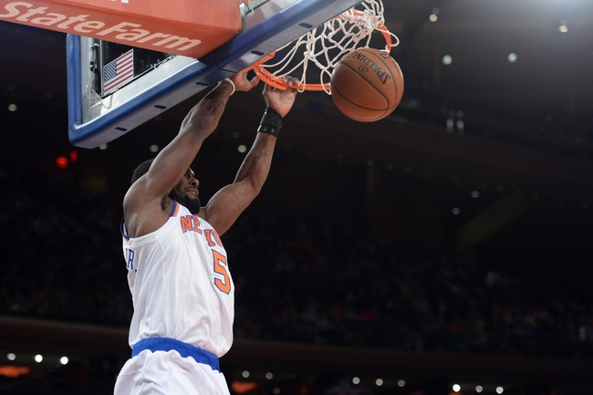 Jan 28, 2014; New York, NY, USA; New York Knicks shooting guard Tim Hardaway Jr. (5) converts an ally oop dunk against the Boston Celtics during the second half at Madison Square Garden. The New York Knicks won the game 114-88. Mandatory Credit: Joe Camporeale-USA TODAY Sports