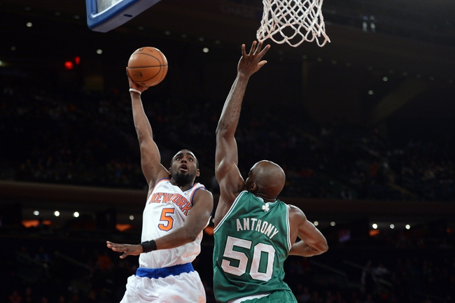 Jan 28, 2014; New York, NY, USA; New York Knicks shooting guard Tim Hardaway Jr. (5) shoots over Boston Celtics center Joel Anthony (50) during the second half at Madison Square Garden. The New York Knicks won the game 114-88. Mandatory Credit: Joe Camporeale-USA TODAY Sports