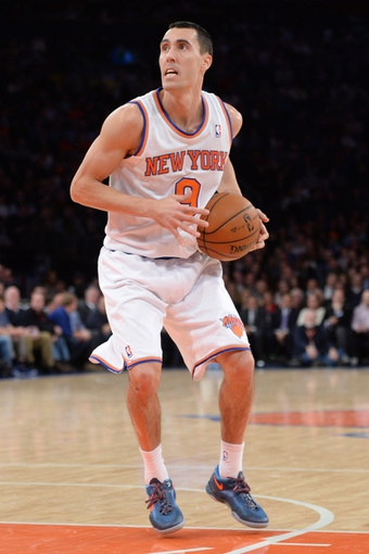 Jan 28, 2014; New York, NY, USA; New York Knicks point guard Pablo Prigioni (9) pulls up for a shot against the Boston Celtics during the second half at Madison Square Garden. The New York Knicks won the game 114-88. Mandatory Credit: Joe Camporeale-USA TODAY Sports