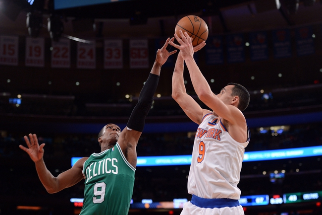 Jan 28, 2014; New York, NY, USA; New York Knicks point guard Pablo Prigioni (9) shoots over Boston Celtics point guard Rajon Rondo (9) during the second half at Madison Square Garden. The New York Knicks won the game 114-88. Mandatory Credit: Joe Camporeale-USA TODAY Sports