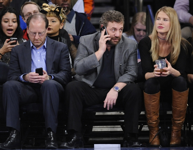 Jan 28, 2014; New York, NY, USA; President and CEO of Cablevision Systems Corporation and Executive Chairman of The Madison Square Garden company James Dolan makes a phone call during the second half of the game between the New York Knicks and the Boston Celtics at Madison Square Garden. The New York Knicks won the game 114-88. Mandatory Credit: Joe Camporeale-USA TODAY Sports