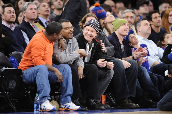 Jan 28, 2014; New York, NY, USA; American actor Timothy Hutton (black/white knit cap) looks on during the second half of the game between the New York Knicks and the Boston Celtics at Madison Square Garden. The New York Knicks won the game 114-88. Mandatory Credit: Joe Camporeale-USA TODAY Sports