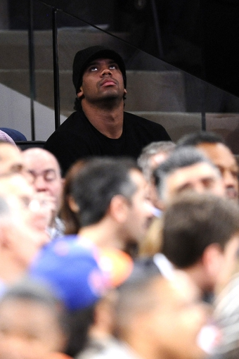 Jan 28, 2014; New York, NY, USA; Seattle Seahawks quarterback Russell Wilson looks  during the second half of the game between the New York Knicks and the Boston Celtics at Madison Square Garden. The New York Knicks won the game 114-88. Mandatory Credit: Joe Camporeale-USA TODAY Sports