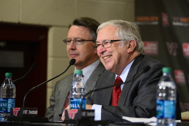Jan 29, 2014; Blacksburg, VA, USA; President Charles Steger speaks as Dr Timothy Sands is in the background during a press conference to introduce new athletic director Whit Babcock at Lane Stadium. Mandatory Credit: Bob Donnan-USA TODAY Sports