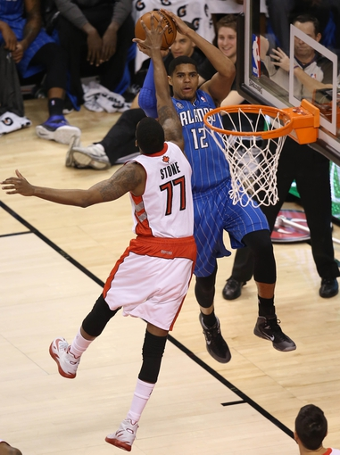 Jan 29, 2014; Toronto, Ontario, CAN; Orlando Magic forward Tobias Harris (12) shoots and scores a basket from behind the baseline against the Toronto Raptors at Air Canada Centre. Mandatory Credit: Tom Szczerbowski-USA TODAY Sports