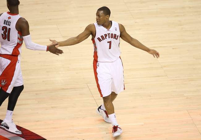 Jan 29, 2014; Toronto, Ontario, CAN; Toronto Raptors point guard Kyle Lowry (7) is congratulated by guard Terrence Ross (31) after scoring a basket against the Orlando Magic at Air Canada Centre. The Raptors beat the Magic 98-83. Mandatory Credit: Tom Szczerbowski-USA TODAY Sports