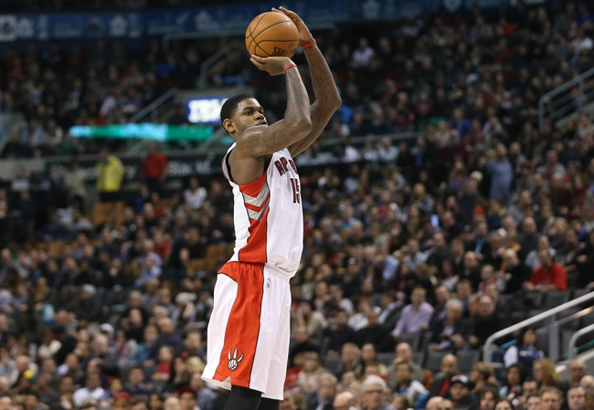 Jan 29, 2014; Toronto, Ontario, CAN; Toronto Raptors forward Amir Johnson (15) shoots against the Orlando Magic at Air Canada Centre. The Raptors beat the Magic 98-83. Mandatory Credit: Tom Szczerbowski-USA TODAY Sports