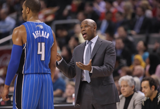 Jan 29, 2014; Toronto, Ontario, CAN; Orlando Magic head coach Jacque Vaughn talks to shooting guard Arron Afflalo (4) against the Toronto Raptors at Air Canada Centre. The Raptors beat the Magic 98-83. Mandatory Credit: Tom Szczerbowski-USA TODAY Sports