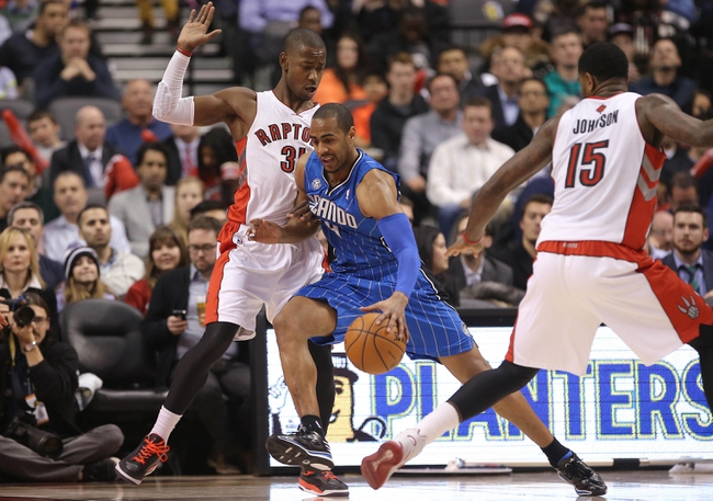 Jan 29, 2014; Toronto, Ontario, CAN; Orlando Magic shooting guard Arron Afflalo (4) goes up against Toronto Raptors guard Terrence Ross (31) at Air Canada Centre. The Raptors beat the Magic 98-83. Mandatory Credit: Tom Szczerbowski-USA TODAY Sports