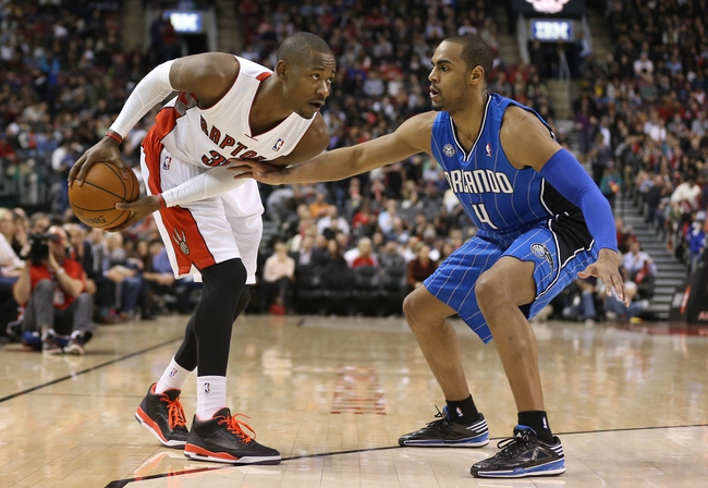 Jan 29, 2014; Toronto, Ontario, CAN; Toronto Raptors guard Terrence Ross (31) goes up against Orlando Magic forward Arron Afflalo (4) at Air Canada Centre. The Raptors beat the Magic 98-83. Mandatory Credit: Tom Szczerbowski-USA TODAY Sports