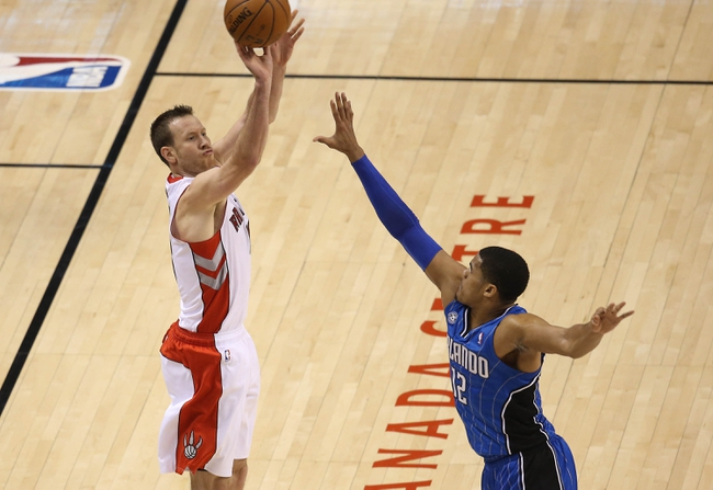 Jan 29, 2014; Toronto, Ontario, CAN; Toronto Raptors forward Steve Novak (16) hits a shot against the Orlando Magic at Air Canada Centre. The Raptors beat the Magic 98-83. Mandatory Credit: Tom Szczerbowski-USA TODAY Sports